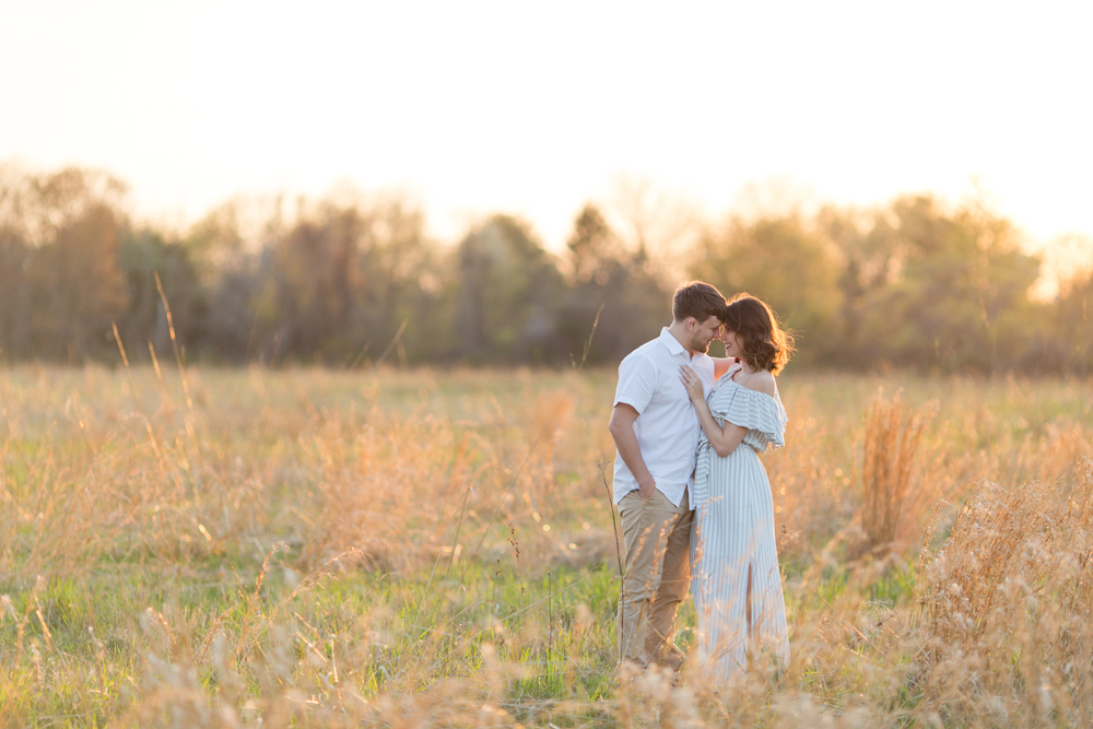 couple posing in field
