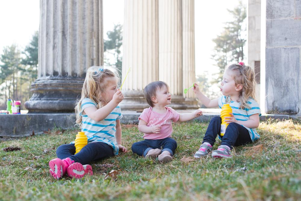 3 kids blow bubbles