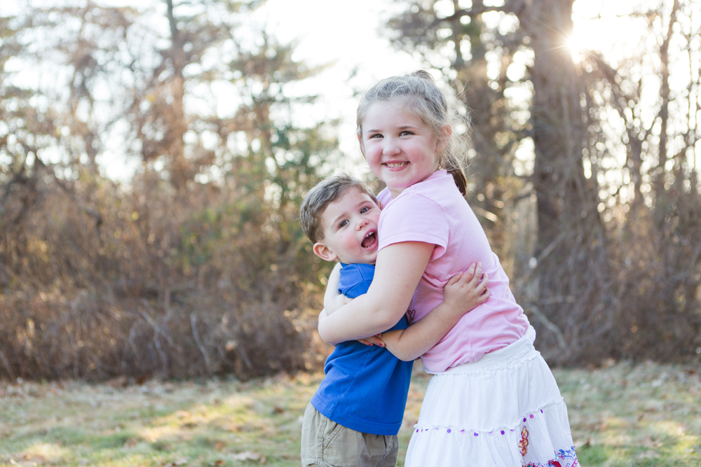 brother and sister hugging