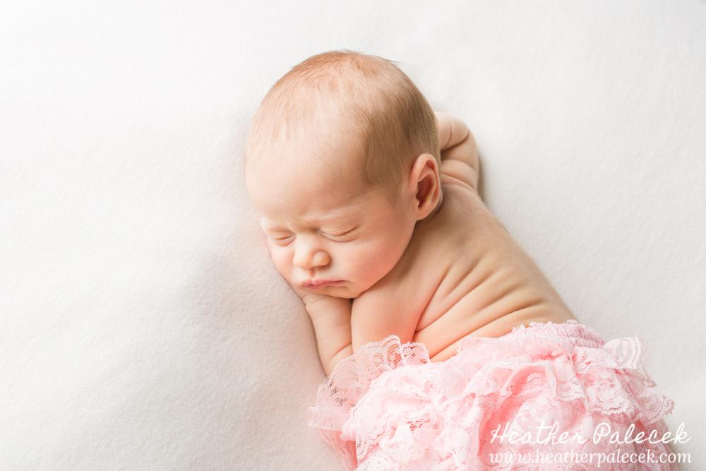 newborn girl in pink diaper cover