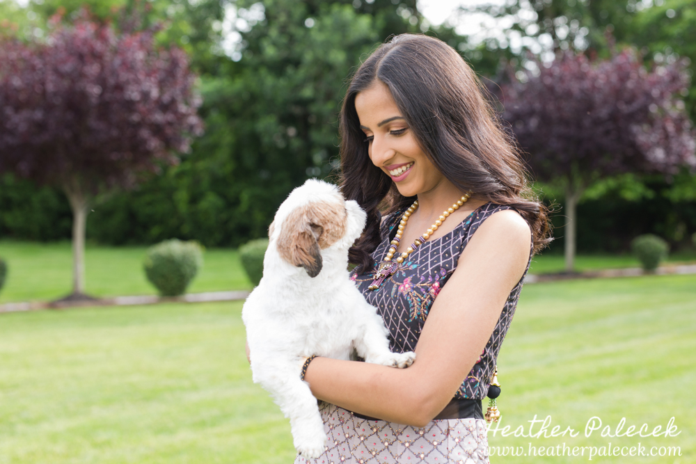 teenage girl poses with her dog for sweet sixteen portrait session