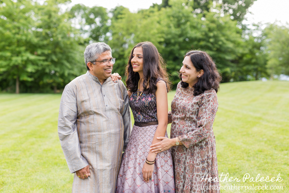 girl and parents pose for sweet sixteen portrait session