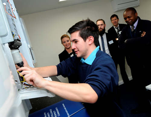 An Energy Academy trainee gets to grips with boiler