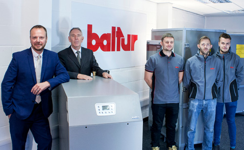 EOGB's technical director Martin Cooke, (far left), and Paul Barritt, (second from left), with members of the EOGB team in the new Baltur UK showroom
