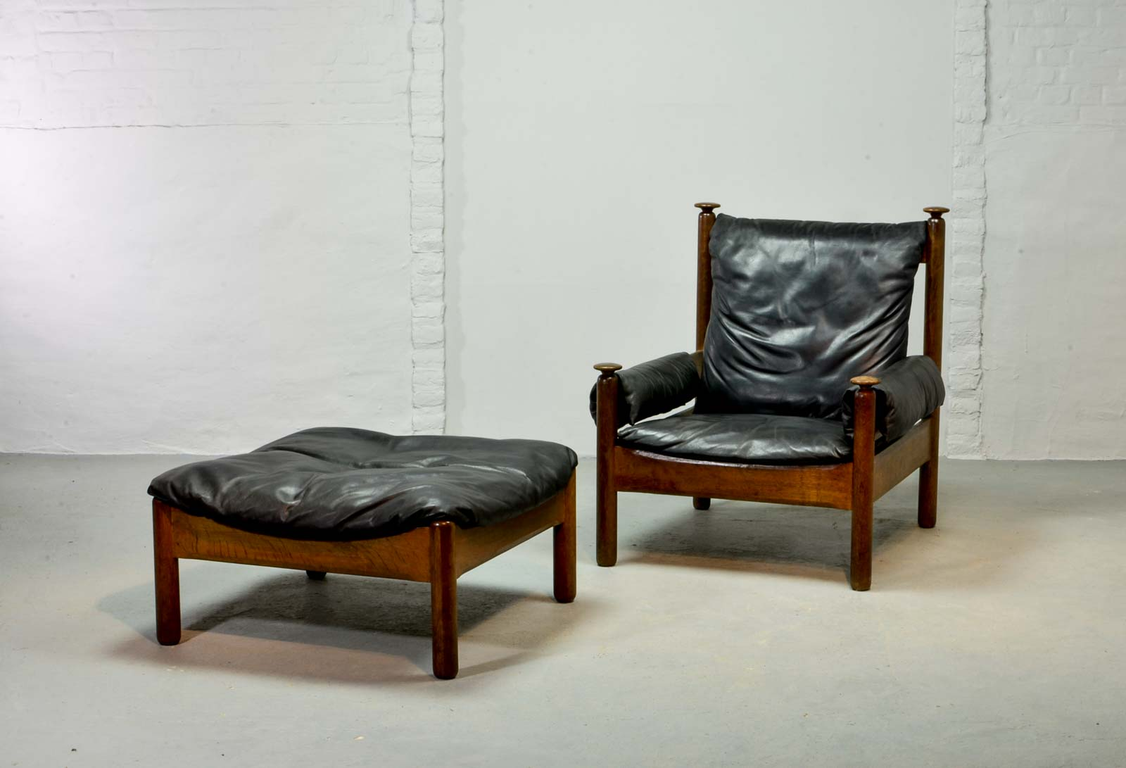 black leather lounge chair with ottoman power wheelchair sturdy mid century scandinavian