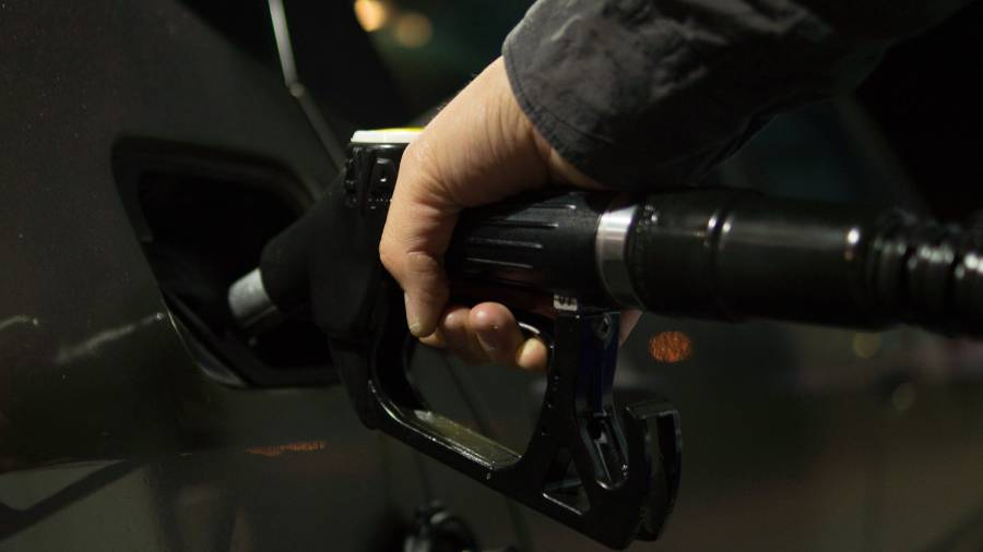 How should firms handle staff who refuse to travel into work to save petrol?