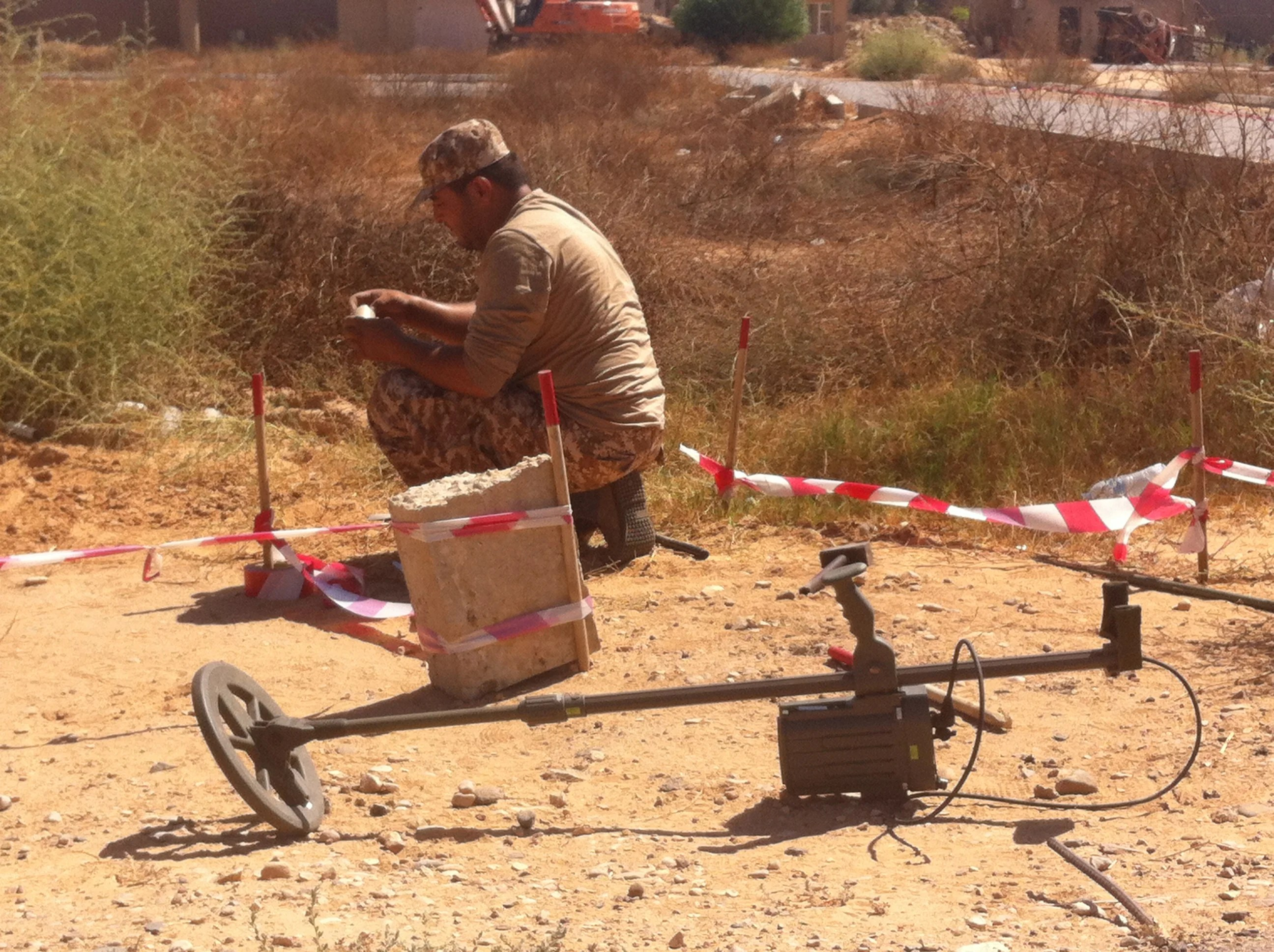 <p>A Libya Dawn Alliance deminer clears T-AB-1 antipersonnel mines from the old airport area at Tripoli International Airport on September 15, 2014.</p>