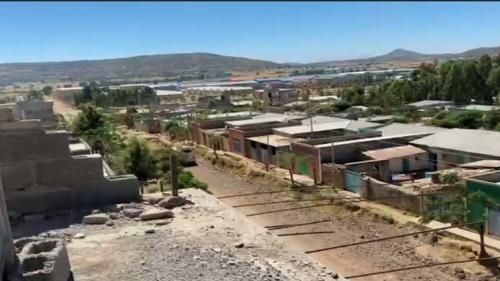 Footage recorded on November 25, 2020 in Axum, Tigray region, appearing to show military trucks and buses moving along the main road through town after the town's capture by Ethiopian and Eritrean federal forces. A blast sound can distinctly be heard in the clip.