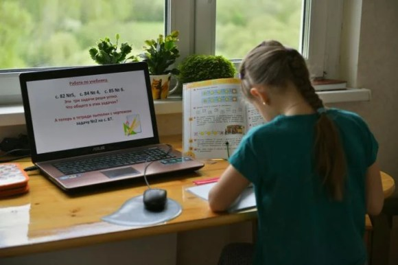 A girl studies from home because of the coronavirus outbreak in Moscow, Russia,
