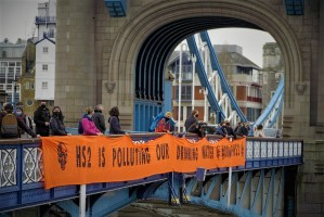 HS2 Rebellion drops banner from Tower Bridge; demanding the government stop HS2 and protect UK drinking water
