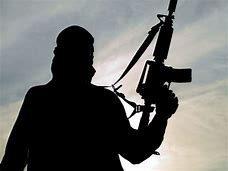 silhouette of a soldier holding machine gun