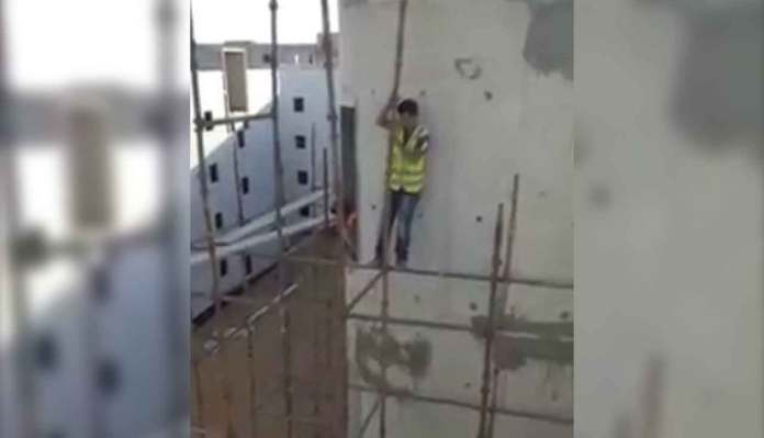 The Worker Working On Scaffolding Without Any Fall Protection
