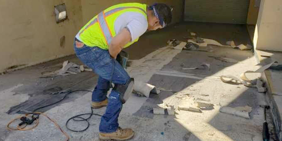 Removing the existing coating from the ramp.