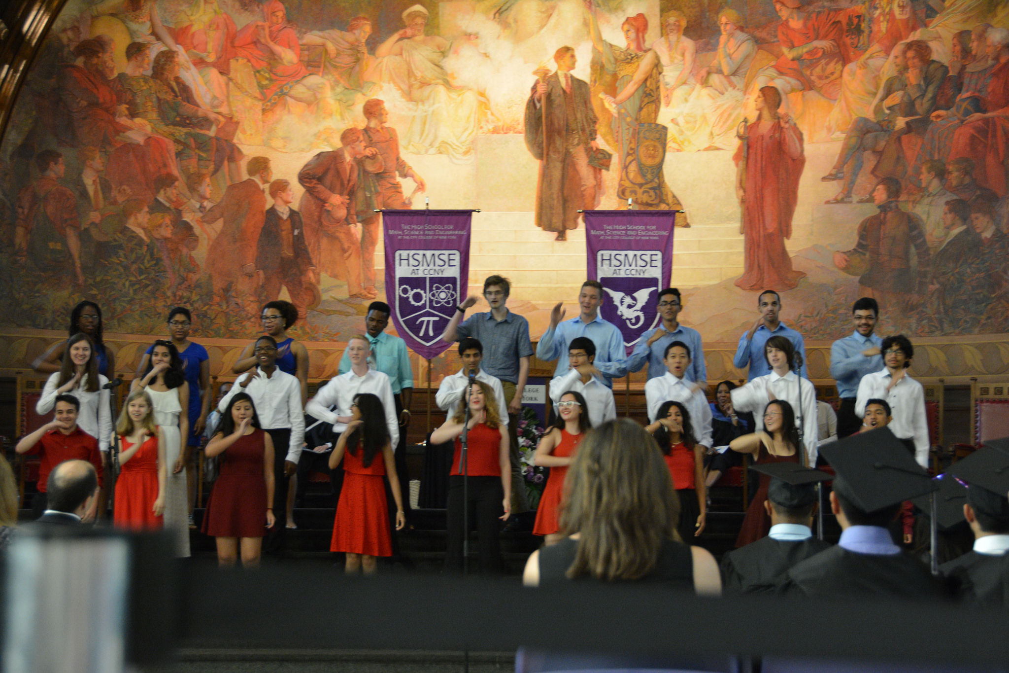 The student chorus performs at graduation