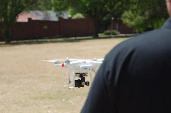 The drone will hover and, if set up correctly, remember where ground level is.