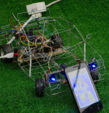 The remote controlled wirework car. The USB cable is keeping the battery topped up.