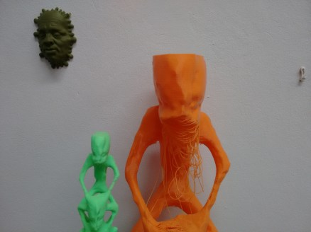 The orange print was made using the larger print head. There is a slight problem with the jaw (no support material was used).