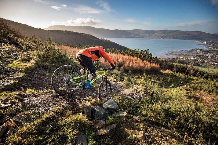 A mountain biker riding a downhill trail