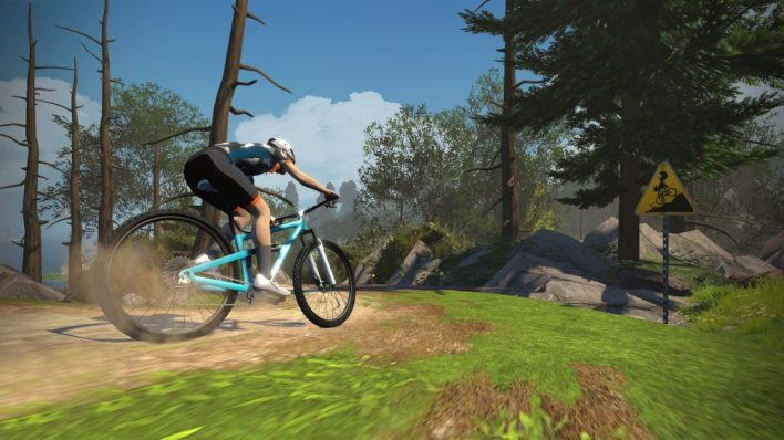 Riding a course on Zwift's MTB trail