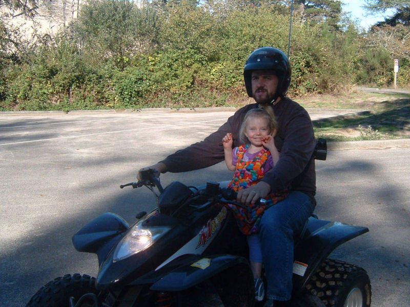 picture of Dad and Mikaela on quad