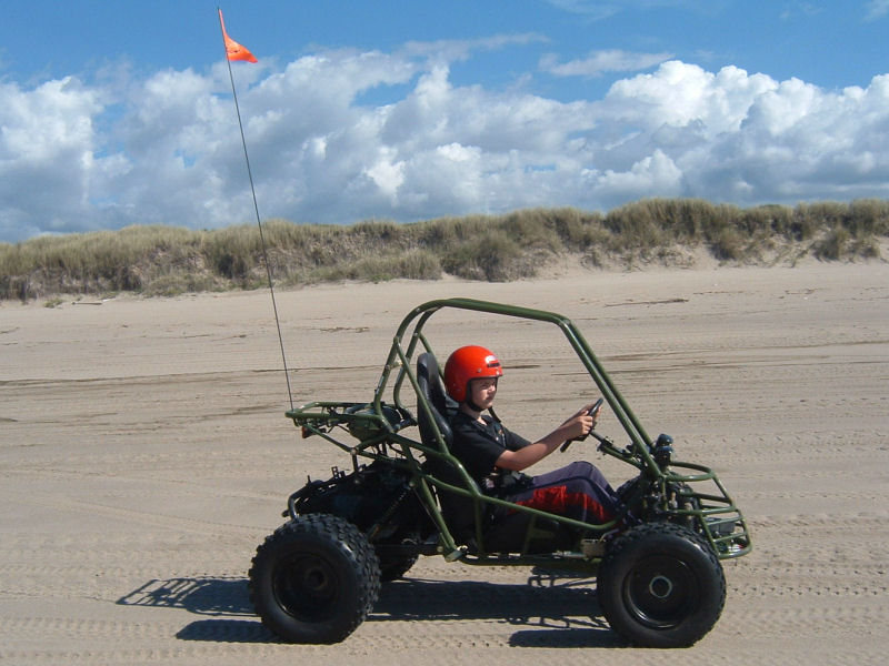 picture of Rett in dune buggy on beach