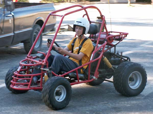 Picture of Layne driving a dune buggy in 2004