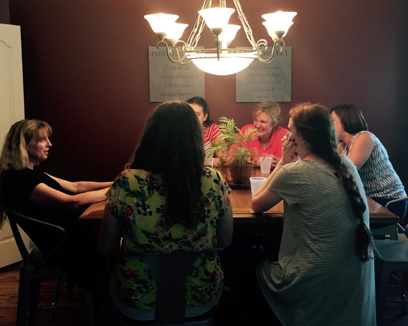 picture of ladies talking in dining room