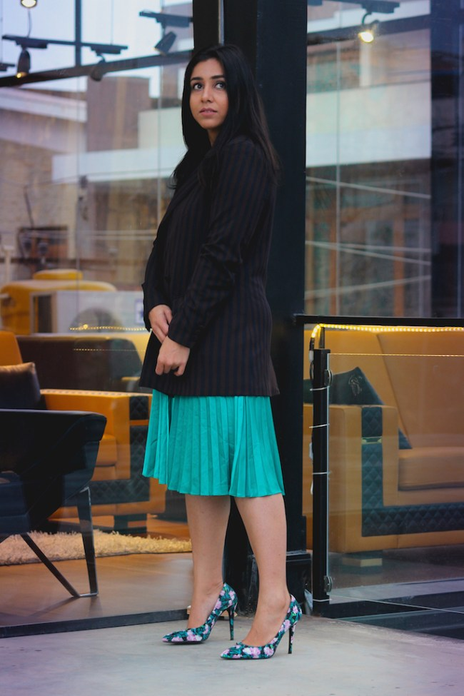 Styling the emerald green pleated skirt
