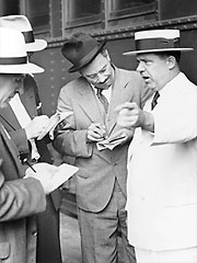Huey Long speaking with reporters