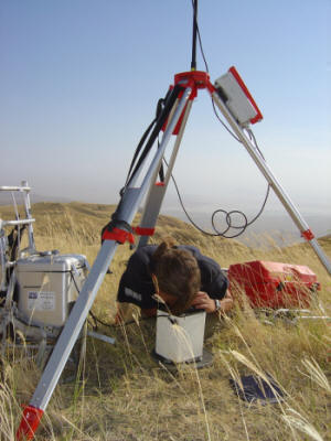 Gravimeter reading on the Serengeti Plateau, with Lake Natron in the background.