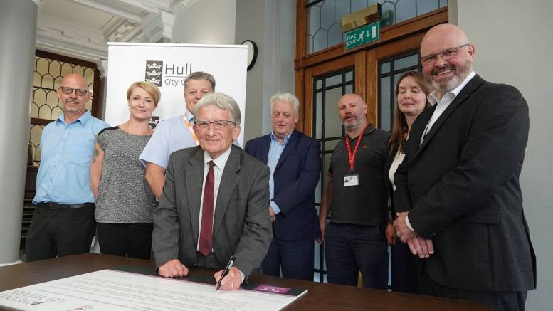Hull City Council leader Stephen Brady signs the 'Dying to Work' Charter at the Guildhall. Above left to right: Neil Ware of GMB, Nikki Osborne of Unison, Dave Oglesby of GMB, Bill Adams of TUC, Dave Curtis of Unite, Jacqui Blesic of Hull City Council, Matt Jukes, chief executive of Hull City Council.