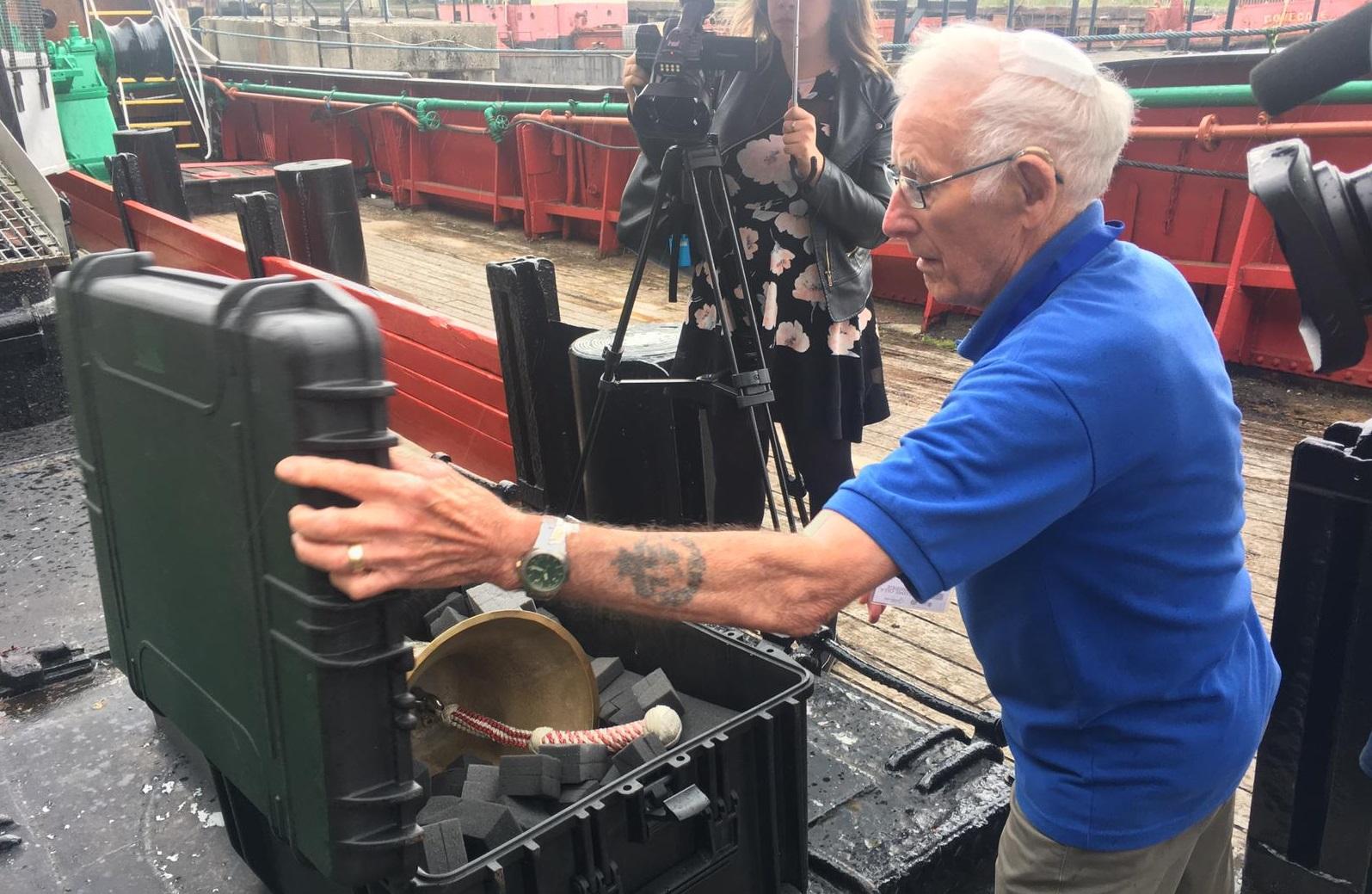 The Arctic Corsair's bell is carefully packed away by volunteer Trevor Evans.