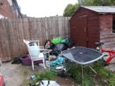 Broken household items left to rot in the garden