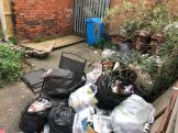 Bags of waste left in garden