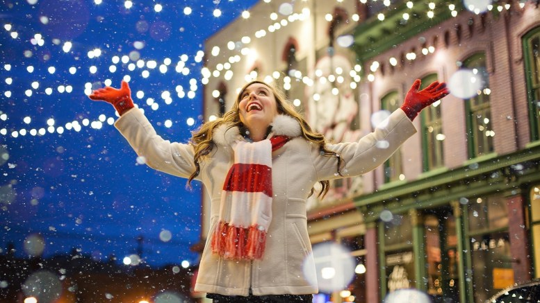 A woman enjoys Christmas lights
