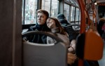 A man and woman on a bus