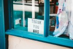 A sign saying 'thank you NHS' in a window