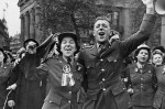 Two people celebrate VE Day in 1945.