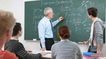 An image of a man teaching a group of students