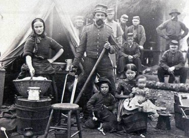 A family at the 31st Pennsylvania Infantry Regiment Camp, near Fort Slocum, Virginia. Wives of Soldiers who followed them to the camps often worked as cooks and laundresses. Living in the camp helped to support the family and improved morale. (Photo courtesy of U.S. Army Heritage and Education Center)