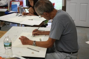 Man in Adult Drawing Class drafting picture