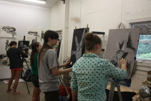 Art Students Painting on Easel