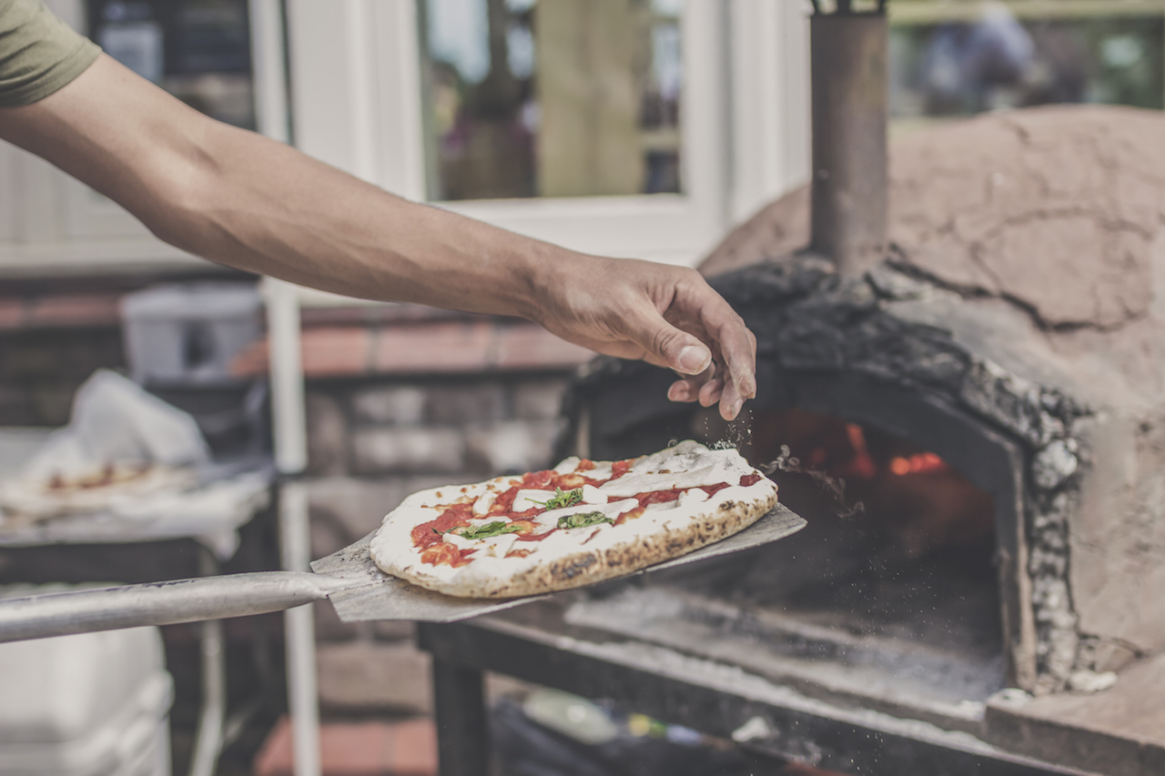 a pizza goes in to the oven