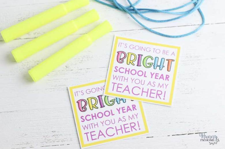 Gather your supplies -- highlighters, printable gift tag, hole punch, and ribbon.