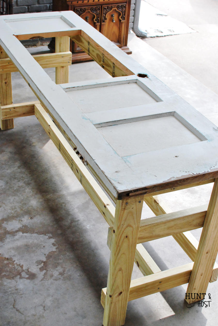 remodelaholic upcycled door into outdoor serving table with sink