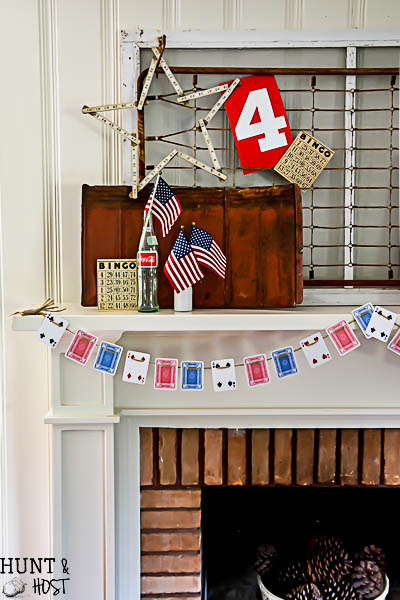 How cute is this playing card garland...great 4th of July decorating ideas here, red, white and blue from the dollar store!