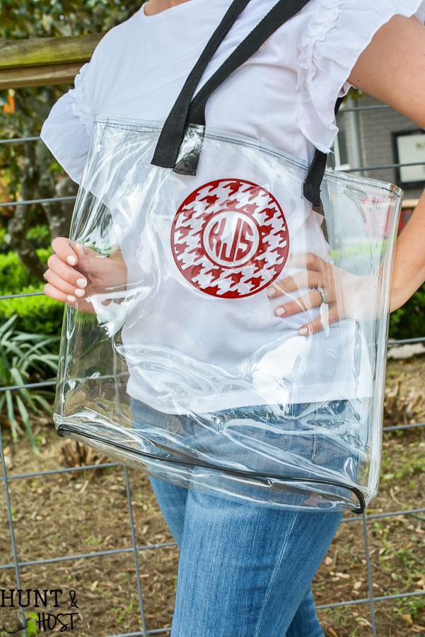 An inexpensive dollar store tote bag gets a cute makeover with a personalized monogram, perfect for summer gift or football game clear tote bag! You will look great by the pool or beach with this clear bag!