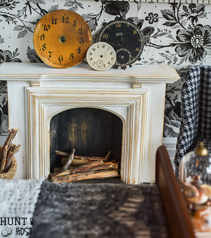 Get lost in in cozy comfort with these dollhouse master bedroom decor ideas. Large scale floral wallpaper make the room a dramatic room with vintage touches, you'll seriously want to move into this dollhouse bedroom! Vintage clocks on the fireplace mantel with a dramatic black and white theme.