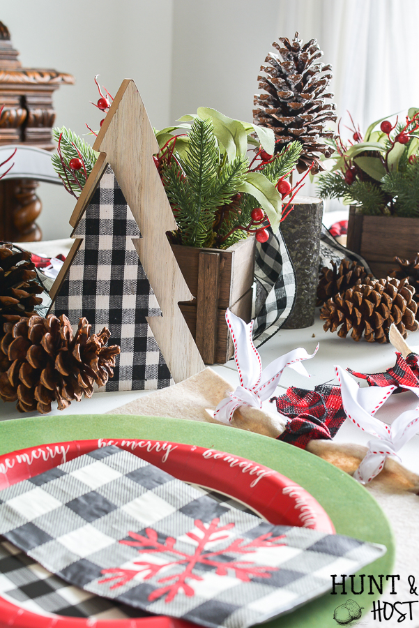 This Christmas go mad for plaid with these precious DIY Christmas placemats, use buffalo check and fabulous CHristmas ribbon to decorate your Christmas table in style with this easy DIY. #ad #handmadewithjoann @JOANN #buffalocheck #plaidholiday #Christmastable #DIYChristmasdecor #easyChristmascraft #christmasribbon