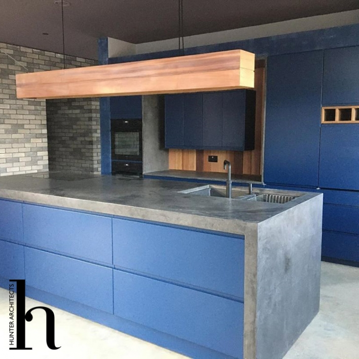 Bespoke kitchen with grey engineering brick wall